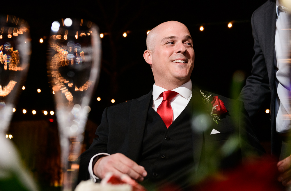 Groom smiling during the reception at the Rails on Wright Street, Classic Red and White Wedding, Lazzat Photography, wedding photography, wedding photographer