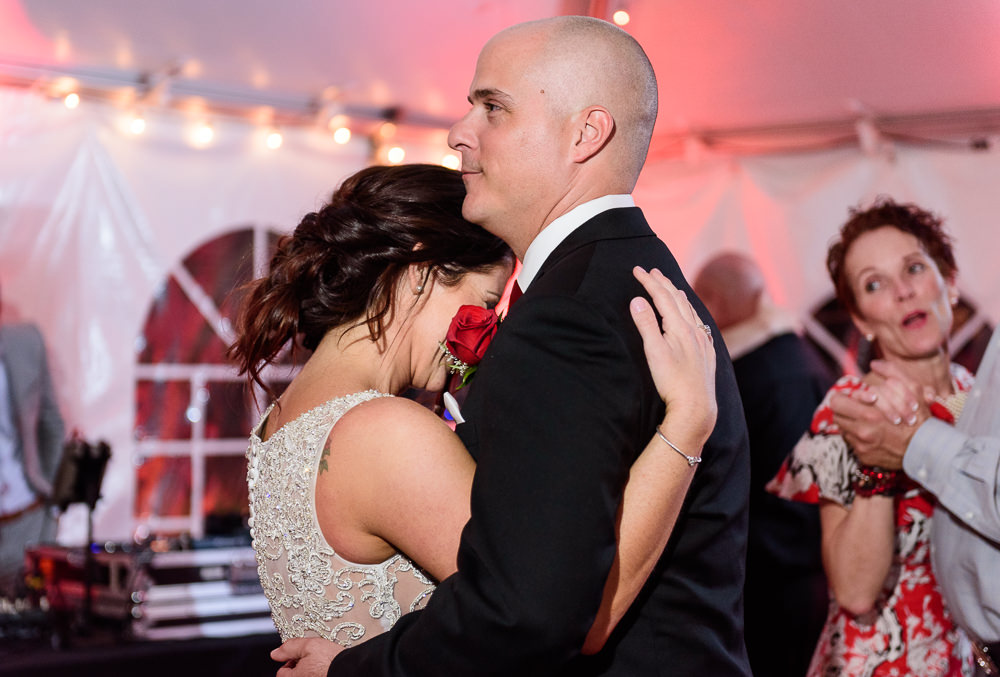 Close up of Bride and Groom dancing during the reception at the Rails on Wright Street, Classic Red and White Wedding, Lazzat Photography, wedding photography, wedding photographer