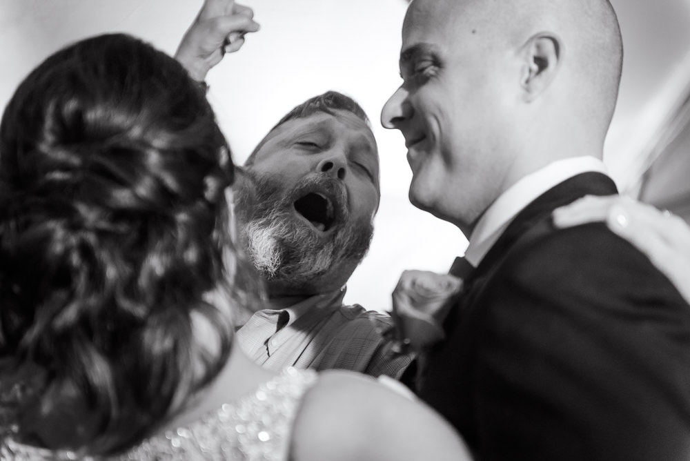 Guest cheering behind the Bride and Groom dancing during the reception at the Rails on Wright Street, Classic Red and White Wedding, Lazzat Photography, wedding photography, wedding photographer