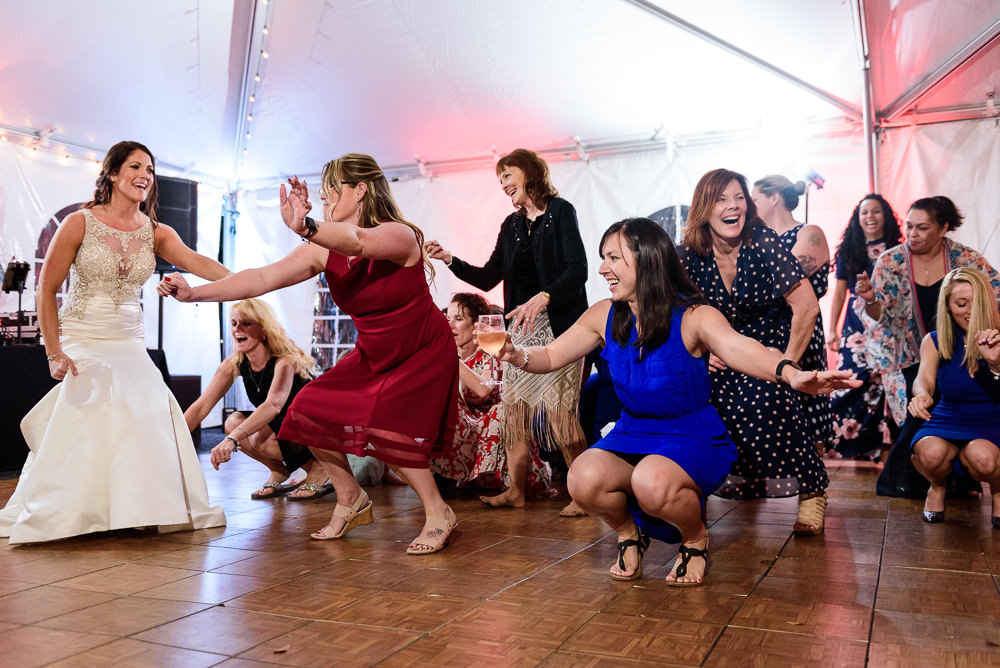 Bride dancing with guests during the reception at the Rails on Wright Street at night, Classic Red and White Wedding, Lazzat Photography, wedding photography, wedding photographer