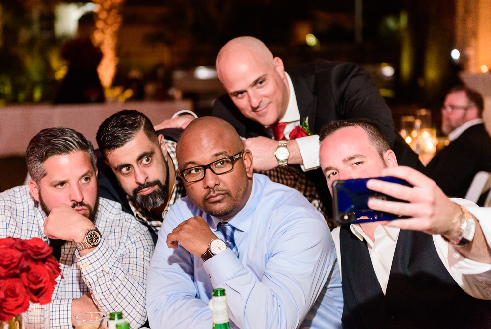 Guests taking a selfie during the reception at the Rails on Wright Street at night, Classic Red and White Wedding, Lazzat Photography, wedding photography, wedding photographer
