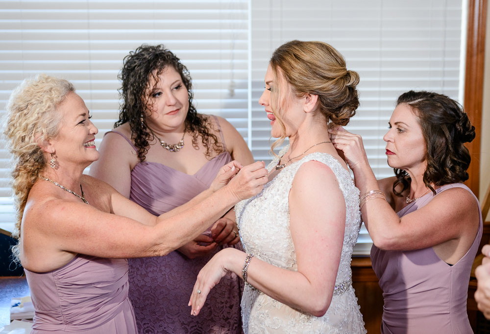 Bride getting dressed by Bridesmaids, Rustic Waterfront Wedding, Fort Walton Beach, Fort Walton Yacht Club, Florida Wedding, Lazzat Photography