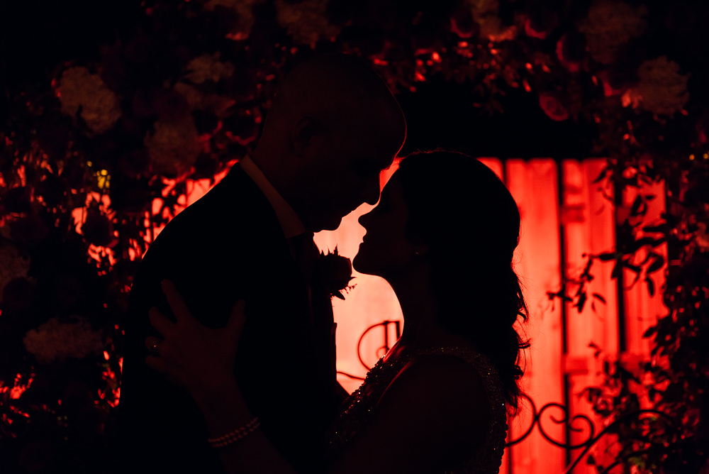 Bride and Groom silhouette in front of their wedding arch at the Rails on Wright Street at night, Classic Red and White Wedding, Lazzat Photography, wedding photography, wedding photographer