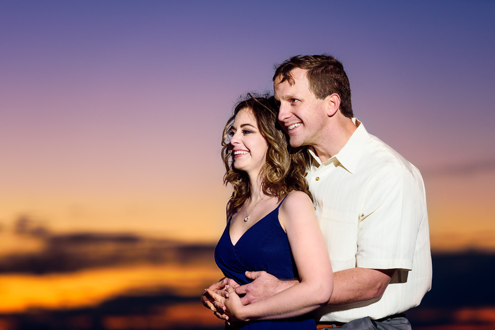 Couple hugging at sunset, Fun Engagement Session at Eden Garden and Fort Pickens, Lazzat Photography, engagement photos