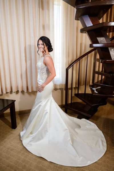 Bride in her gown next to spiral staircase, Pensacola Florida, The Pensacola Grand Hotel, Classic Red and White Wedding, Lazzat Photography