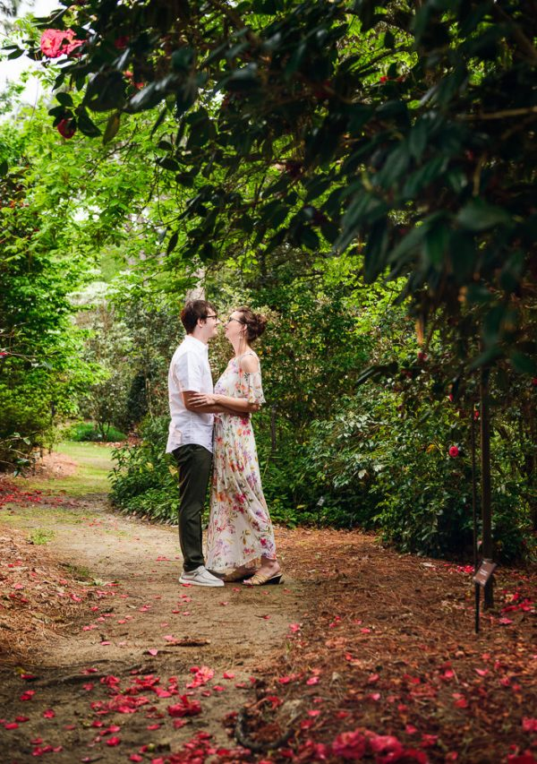 Man and Women smiling at each other, Beautiful Mobile Botanical Gardens Engagement Session, Lazzat Photography