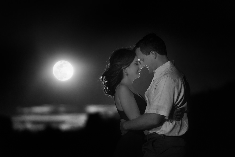 Couple head to head in front of the moon, black and white, Fun Engagement Session at Eden Garden and Fort Pickens, Lazzat Photography, engagement photos