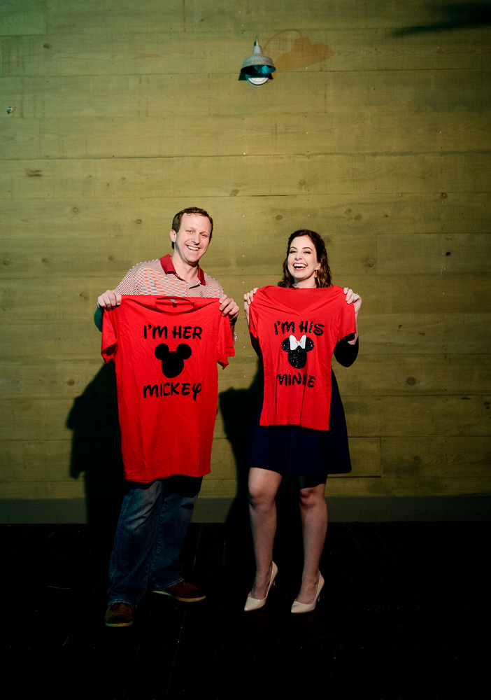 Couple holding custom Disney world shirts, Fun Engagement Session at Eden Garden and Fort Pickens, Lazzat Photography, engagement photos