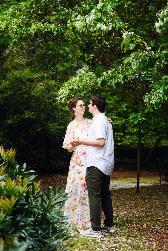 Man and Women dancing in a garden, Beautiful Mobile Botanical Gardens Engagement Session, Lazzat Photography