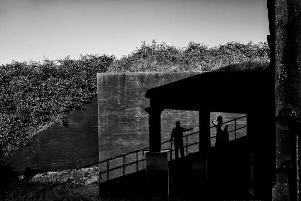 Shadow of couple on the wall, black and white, Fun Engagement Session at Eden Garden and Fort Pickens, Lazzat Photography, engagement photos