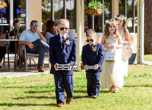 Ring bearers and Flower girls walking down the aisle, Rustic Waterfront Wedding, Fort Walton Beach, Fort Walton Yacht Club, Florida Wedding, Lazzat Photography
