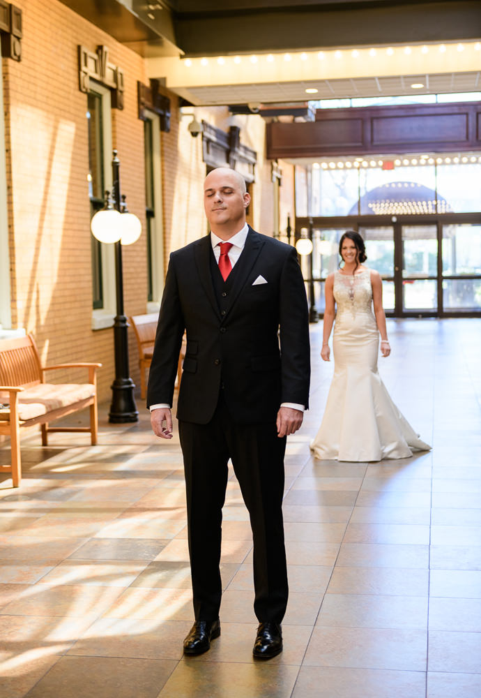 Bride behind her Groom before the first look, The Pensacola Grand Hotel, Classic Red and White Wedding, Lazzat Photography