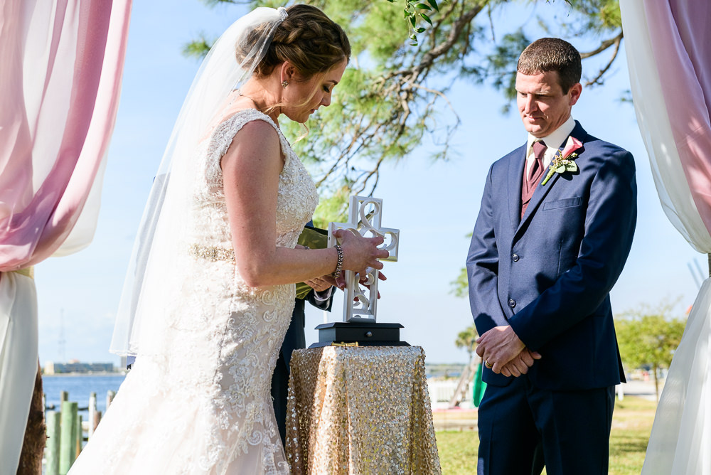 Bride and Groom at the waterfront alter with their unity cross, Rustic Waterfront Wedding, Fort Walton Beach, Fort Walton Yacht Club, Florida Wedding, Lazzat Photography