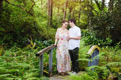 Couple on a bridge in a garden, Beautiful Mobile Botanical Gardens Engagement Session, Lazzat Photography
