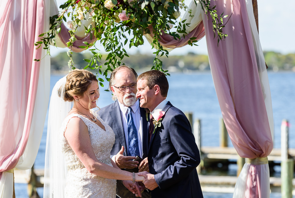 Close up of Bride and Groom at the waterfront alter, Rustic Waterfront Wedding, Fort Walton Beach, Fort Walton Yacht Club, Florida Wedding, Lazzat Photography
