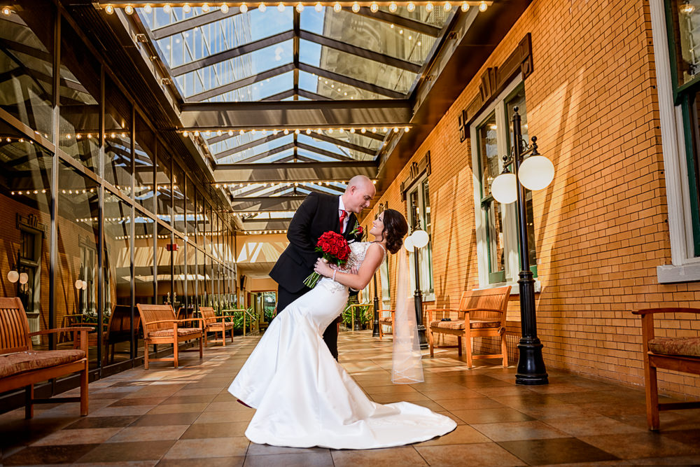 Groom dipping Bride after the first look, The Pensacola Grand Hotel, Classic Red and White Wedding, Lazzat Photography