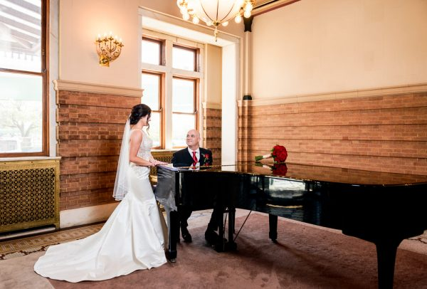 Groom playing piano for the Bride, The Pensacola Grand Hotel, Classic Red and White Wedding, Lazzat Photography