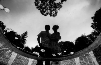Couple's black and white reflection in water, Beautiful Mobile Botanical Gardens Engagement Session, Lazzat Photography