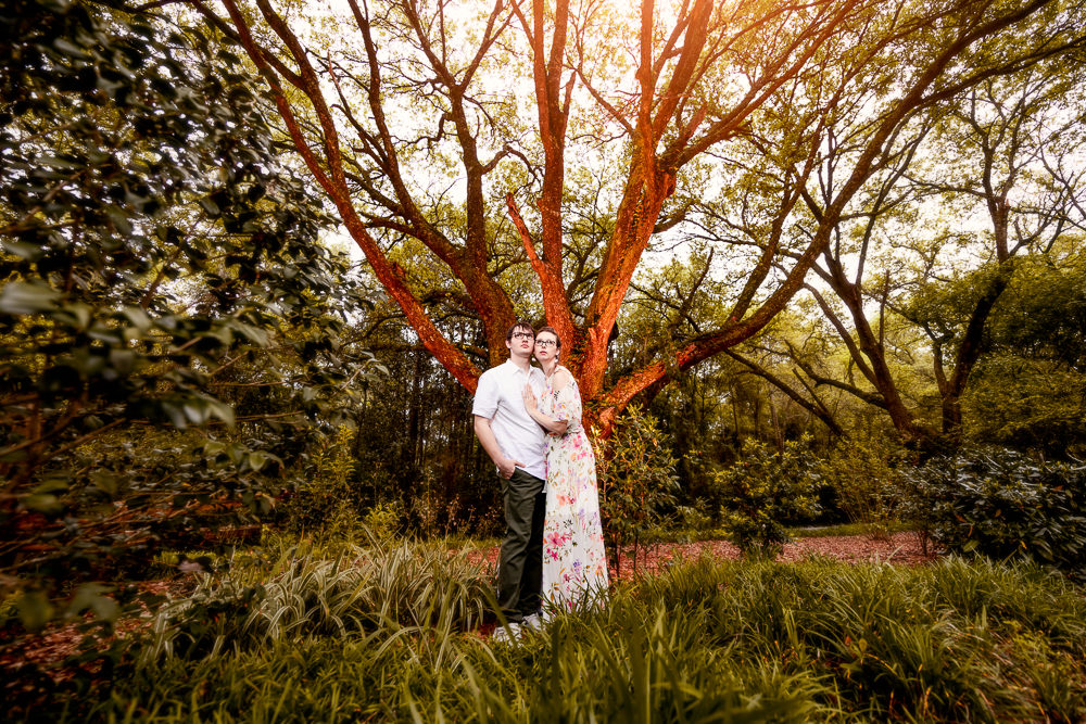 Couple looking up in front of a epic red tree, Beautiful Mobile Botanical Gardens Engagement Session, Lazzat Photography