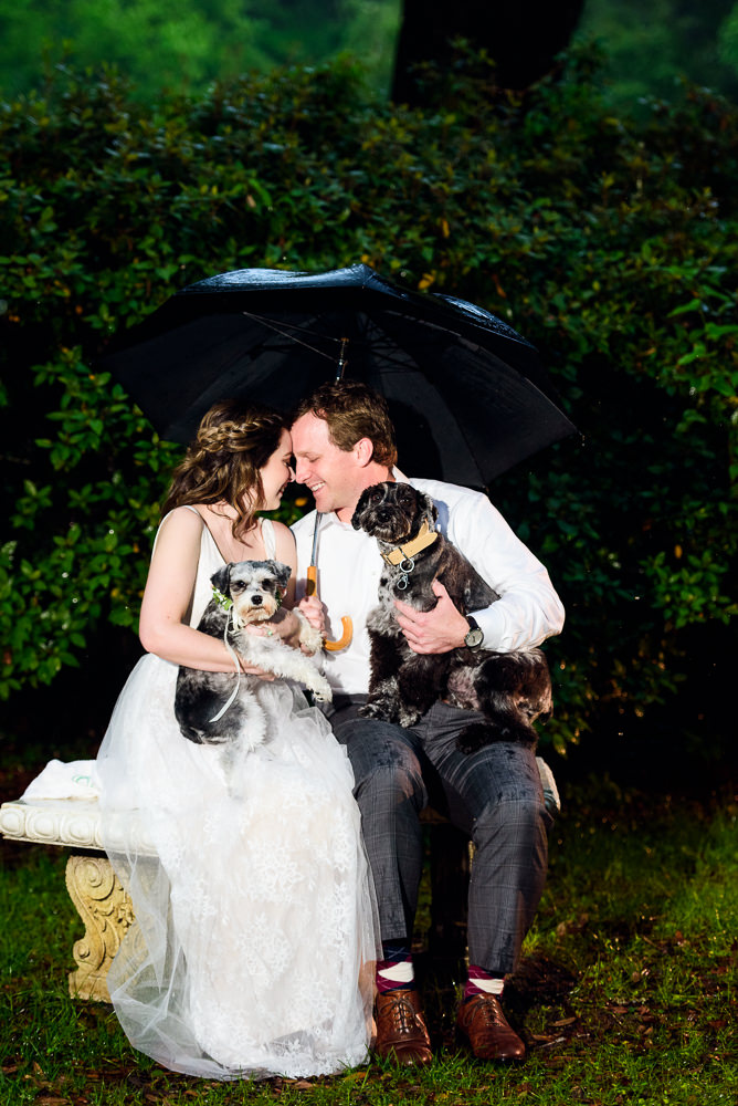 Couple head to head with their dogs on their laps, Fun Engagement Session at Eden Garden and Fort Pickens, Lazzat Photography, engagement photos