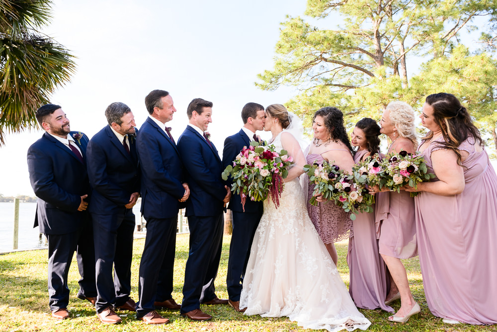 Bride and Groom kissing with their wedding party, Fort Walton Beach, Fort Walton Yacht Club, Florida Wedding, Lazzat Photography