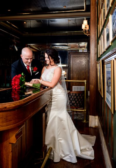 Bride and Groom by the bar at The Pensacola Grand Hotel, Classic Red and White Wedding, Lazzat Photography
