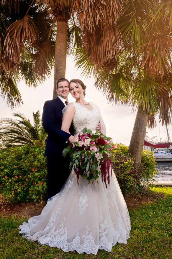 Bride and Groom smiling at the camera under a tree, Fort Walton Beach, Fort Walton Yacht Club, Florida Wedding, Lazzat Photography