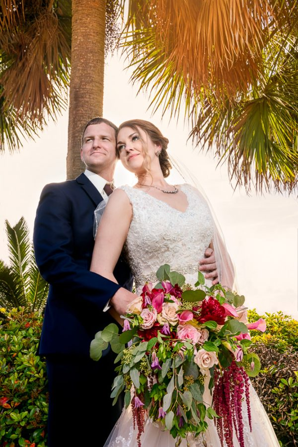 Bride and Groom looking into the distance under a tree, Fort Walton Beach, Fort Walton Yacht Club, Florida Wedding, Lazzat Photography