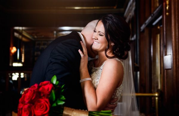 Groom kissing Brides neck at The Pensacola Grand Hotel, Classic Red and White Wedding, Lazzat Photography