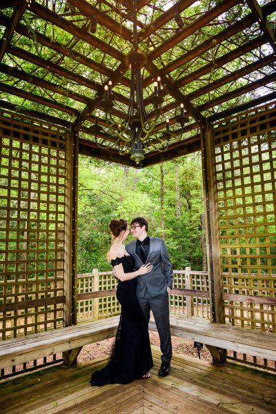 Couple under a wooden gazebo, Beautiful Mobile Botanical Gardens Engagement Session, Lazzat Photography