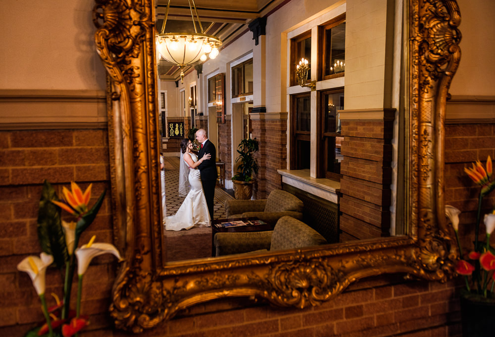 Bride and Groom's reflection in the mirror at the Pensacola Grand Hotel, Classic Red and White Wedding, Lazzat Photography, wedding photography, wedding photographer