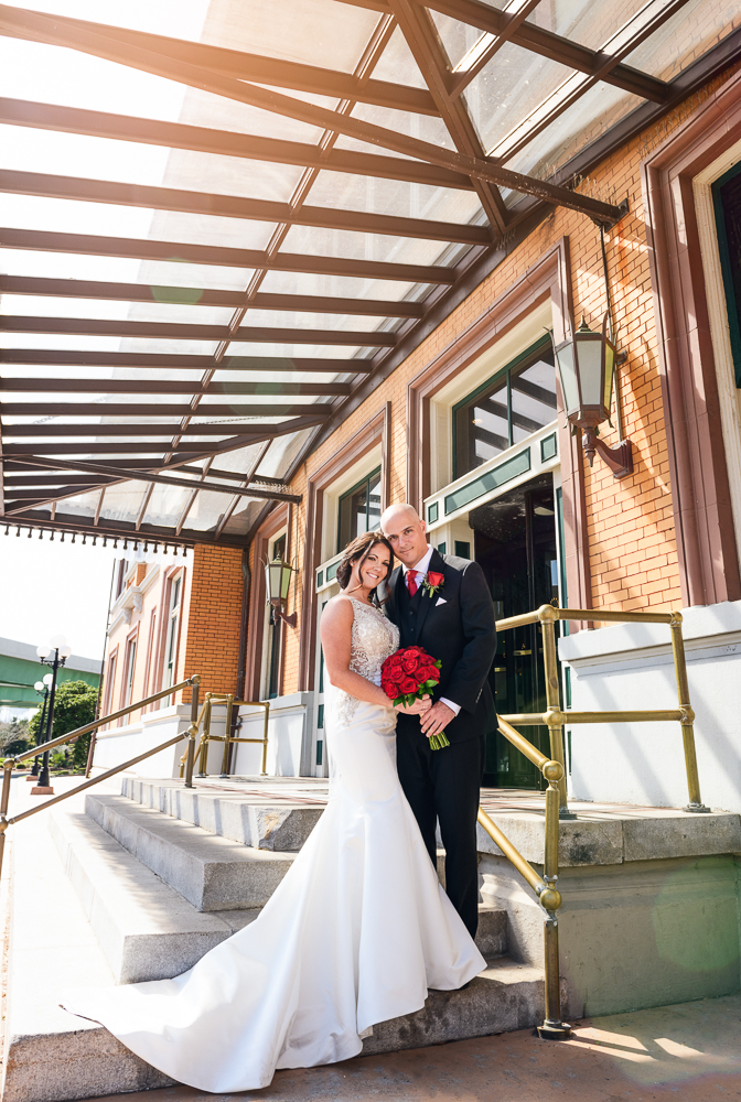 Bride and Groom outside the Pensacola Grand Hotel, Classic Red and White Wedding, Lazzat Photography, wedding photography, wedding photographer