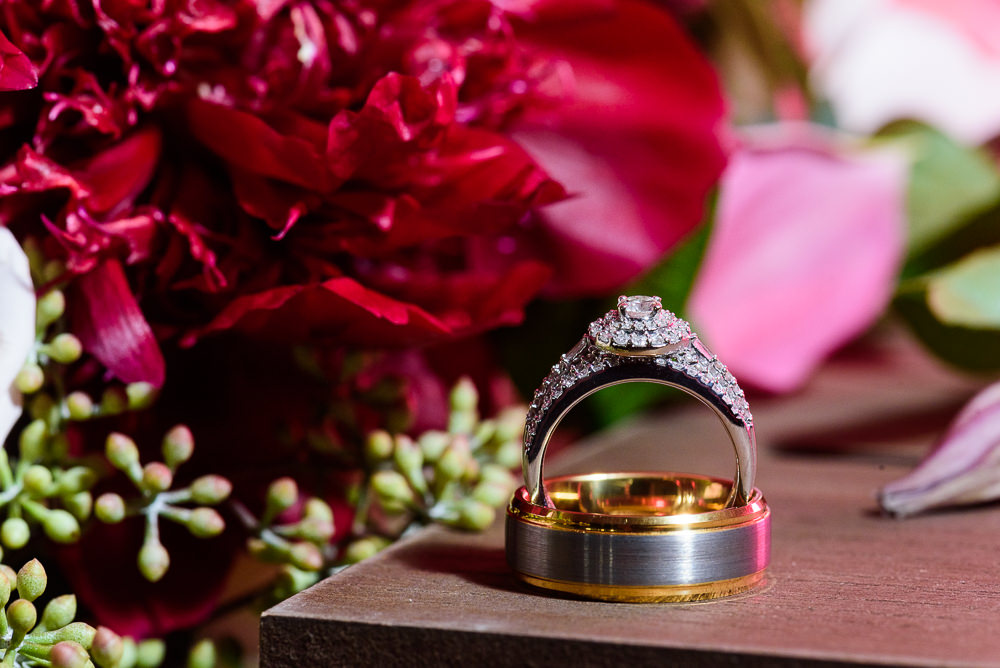 Bride and Groom's wedding bands in front of flowers, Fort Walton Beach, Fort Walton Yacht Club, Florida Wedding, Lazzat Photography