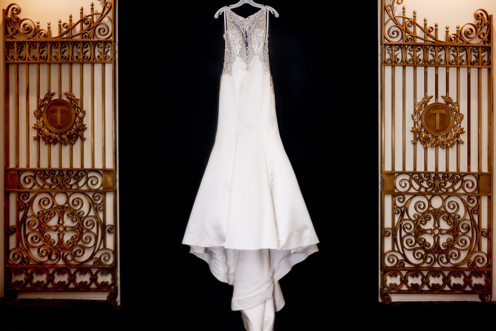 Wedding Gown hanging in gateway, Pensacola Florida, The Pensacola Grand Hotel, Classic Red and White Wedding, Lazzat Photography