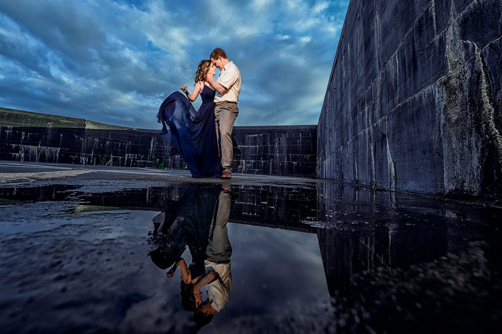 Couple hugging with reflection in a puddle, Fun Engagement Session at Eden Garden and Fort Pickens, Lazzat Photography, engagement photos