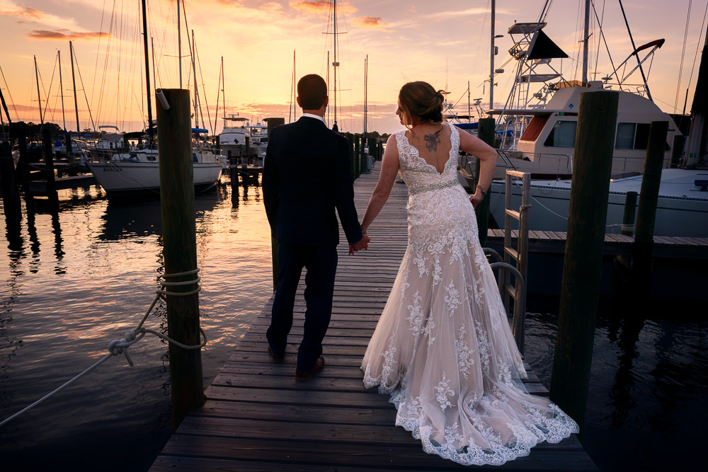 Bride and Groom watching the sunset on the pier, Fort Walton Beach, Fort Walton Yacht Club, Florida Wedding, Lazzat Photography