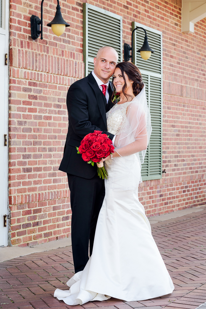 Bride and Groom looking away, downtown Pensacola Florida, bridal gown, wedding gown, Classic Red and White Wedding, Lazzat Photography, wedding photography, wedding photographer