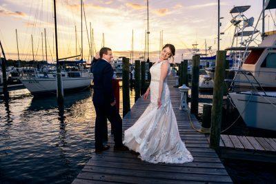 Groom watching the Bride twirl on pier, Fort Walton Beach, Fort Walton Yacht Club, Florida Wedding, Lazzat Photography