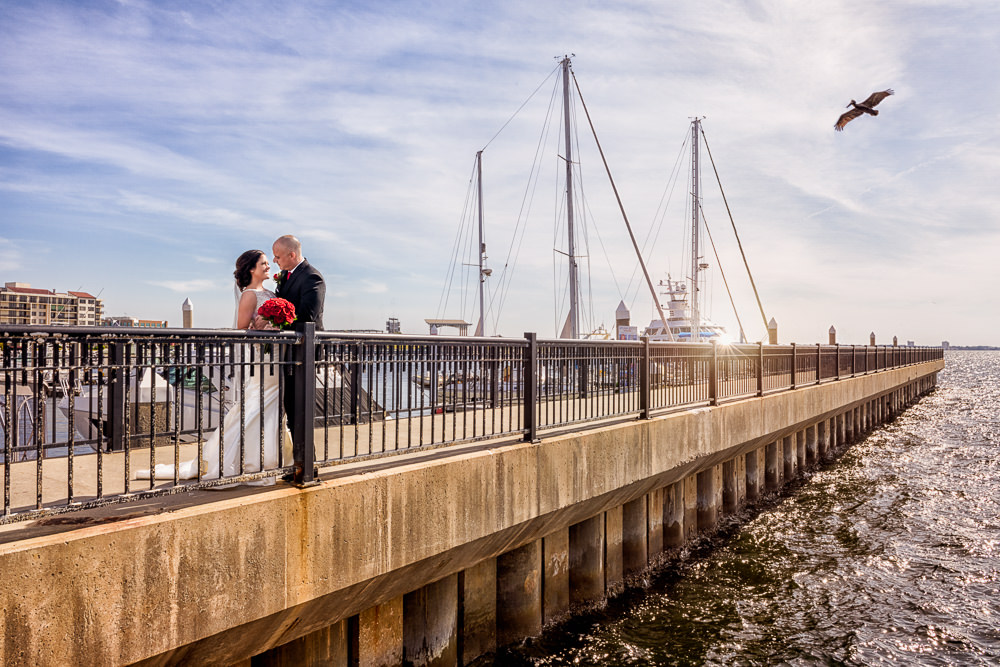 Bride and Groom looking at each other on the pier, downtown Pensacola Florida, Classic Red and White Wedding, Lazzat Photography, wedding photography, wedding photographer