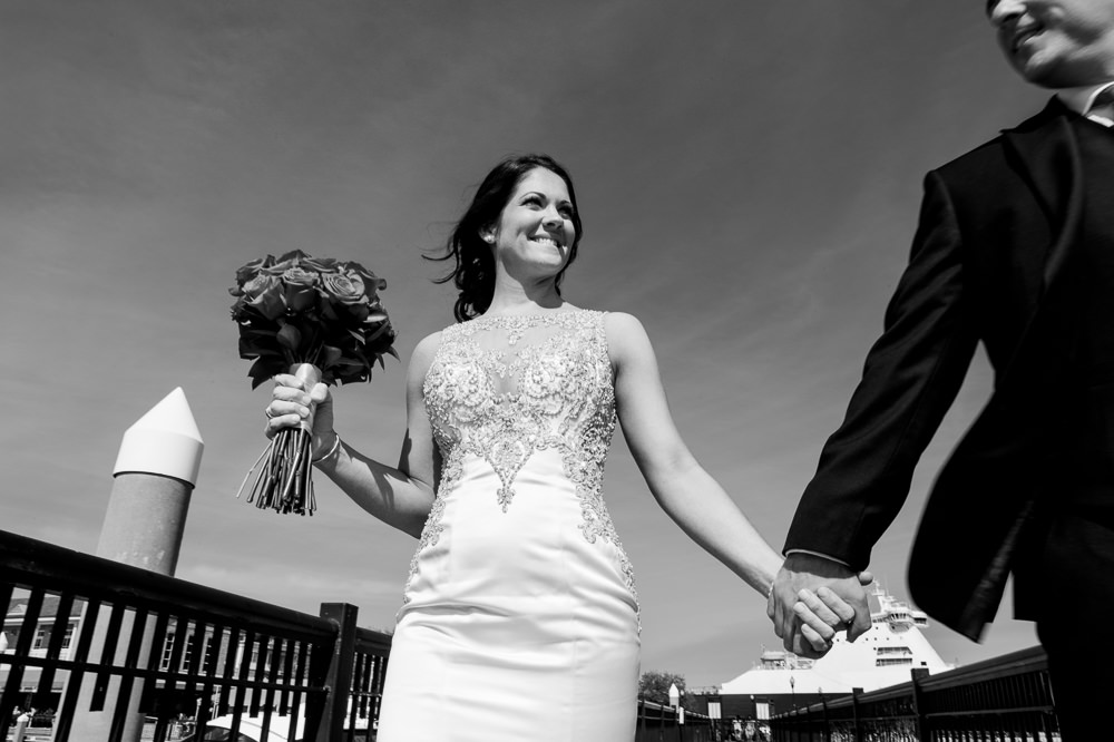 Close up of Bride and Groom walking on the pier downtown Pensacola Florida, black and white, Classic Red and White Wedding, Lazzat Photography, wedding photography, wedding photographer