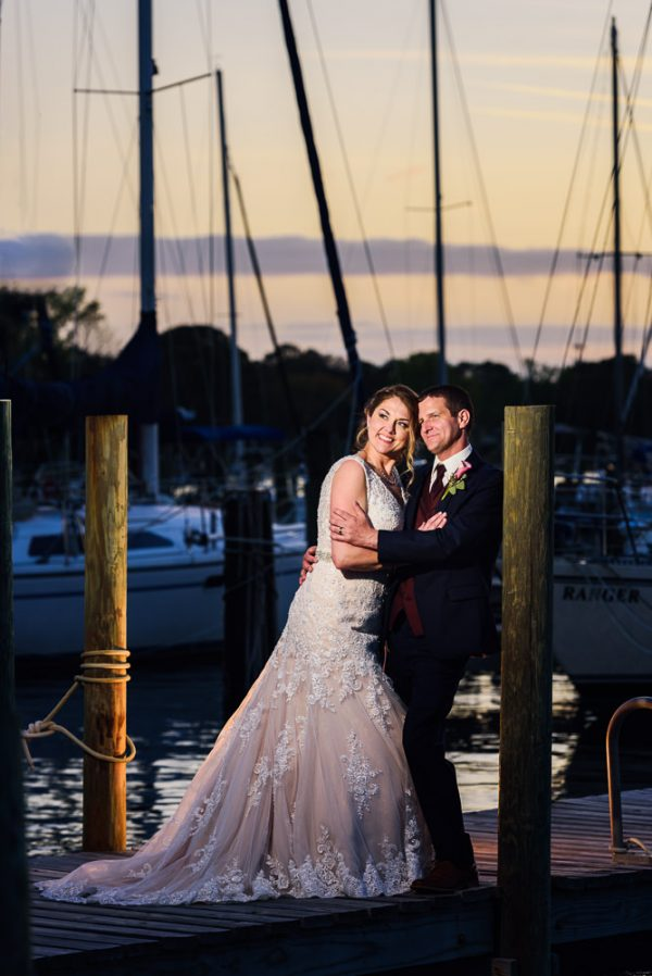 Bride and Groom smiling into the distance on the pier, Fort Walton Beach, Fort Walton Yacht Club, Florida Wedding, Lazzat Photography