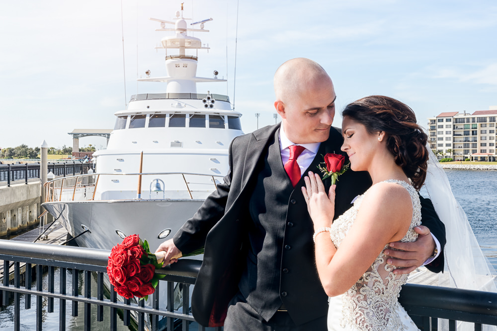 Close up of Bride and Groom hugging on the pier downtown Pensacola Florida, Classic Red and White Wedding, Lazzat Photography, wedding photography, wedding photographer