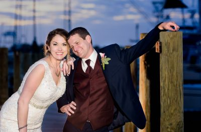 Bride and Groom smiling at the camera on the pier, Fort Walton Beach, Fort Walton Yacht Club, Florida Wedding, Lazzat Photography