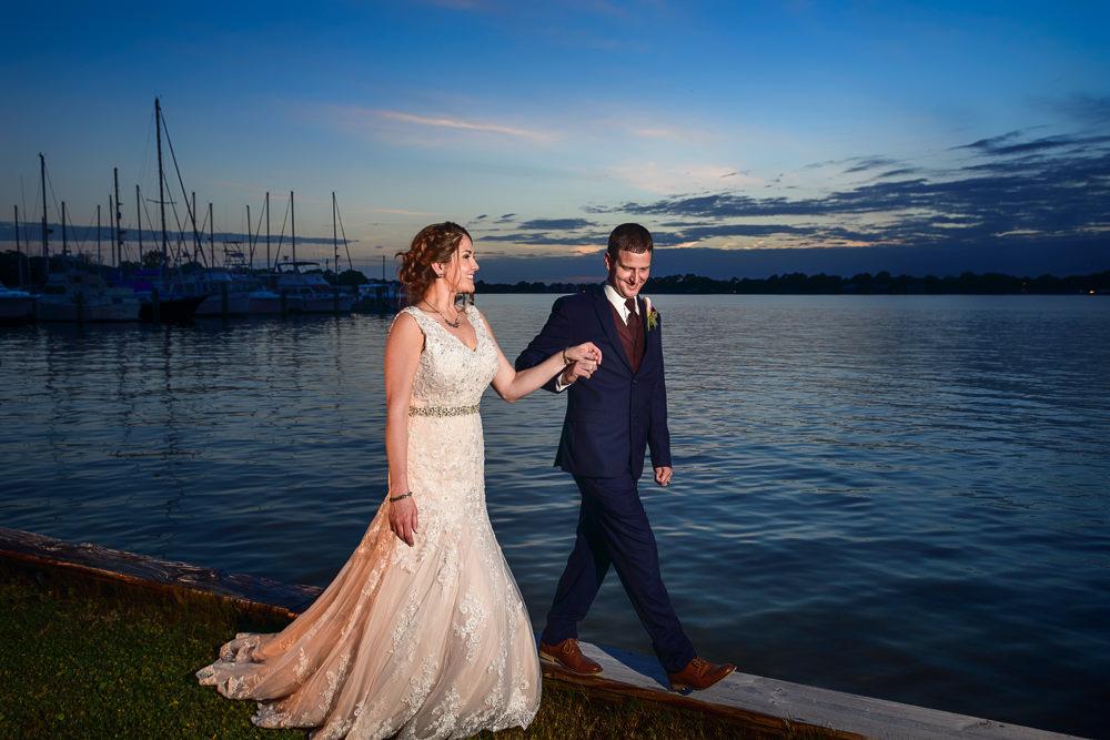 Groom leading Bride along the water, Fort Walton Beach, Fort Walton Yacht Club, Florida Wedding, Lazzat Photography