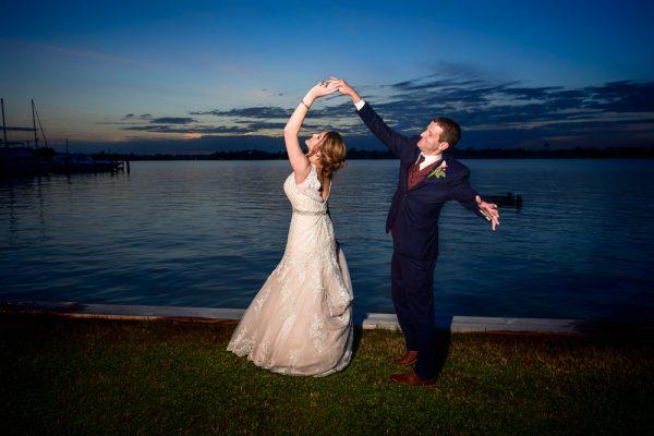 Groom spinning Bride along the water, Fort Walton Beach, Fort Walton Yacht Club, Florida Wedding, Lazzat Photography