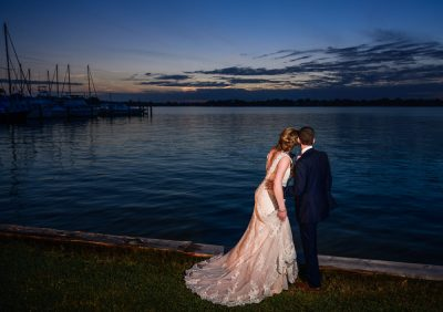 Bride and Groom looking out over the water, Fort Walton Beach, Fort Walton Yacht Club, Florida Wedding, Lazzat Photography