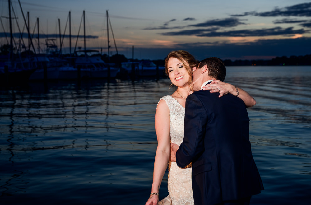 Groom kissing Bride on the neck by the water, Fort Walton Beach, Fort Walton Yacht Club, Florida Wedding, Lazzat Photography