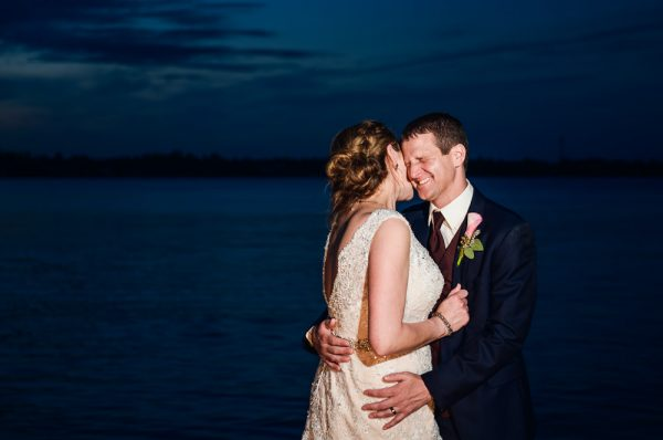 Bride kissing Groom on the neck by the water, Fort Walton Beach, Fort Walton Yacht Club, Florida Wedding, Lazzat Photography