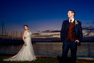Bride and Groom standing apart by the water, Fort Walton Beach, Fort Walton Yacht Club, Florida Wedding, Lazzat Photography