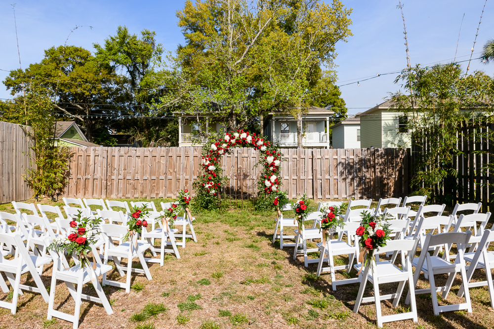 Outdoor wedding ceremony with red rose arch at the Rails on Wright Street, Classic Red and White Wedding, Lazzat Photography, wedding photography, wedding photographer